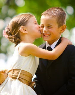 Photo of Flower girl dresses and ring bearer suits at Sophias Style